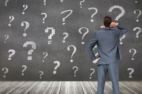 pensive-man-with-question-marks-background_1134-62