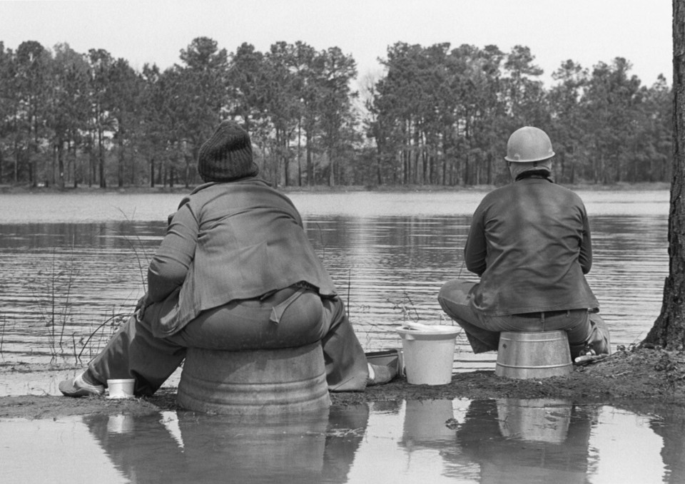 Couple fishing on tubs, Flint River, 1980 Apr Paul